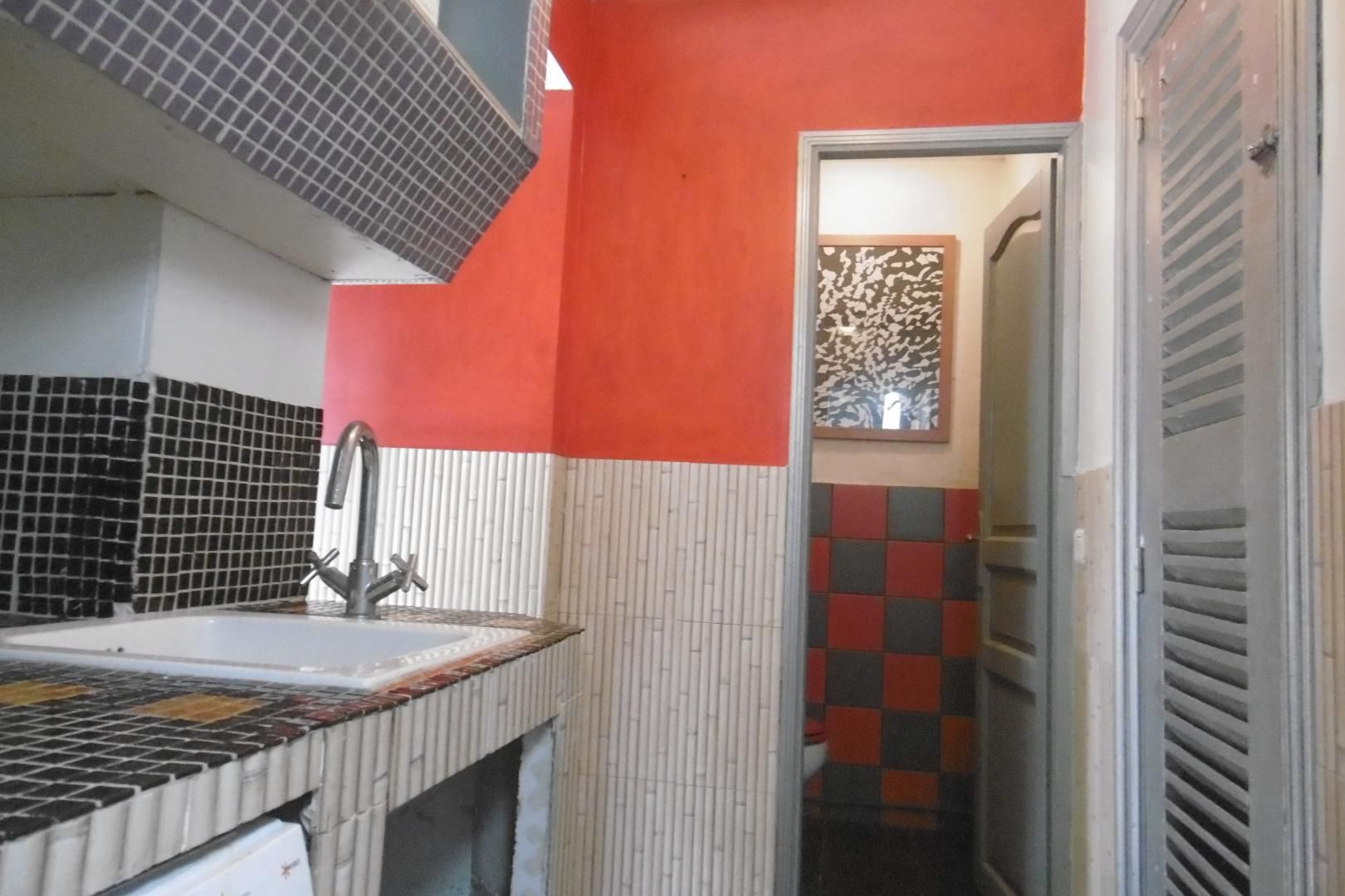 Arrière cuisine et wc