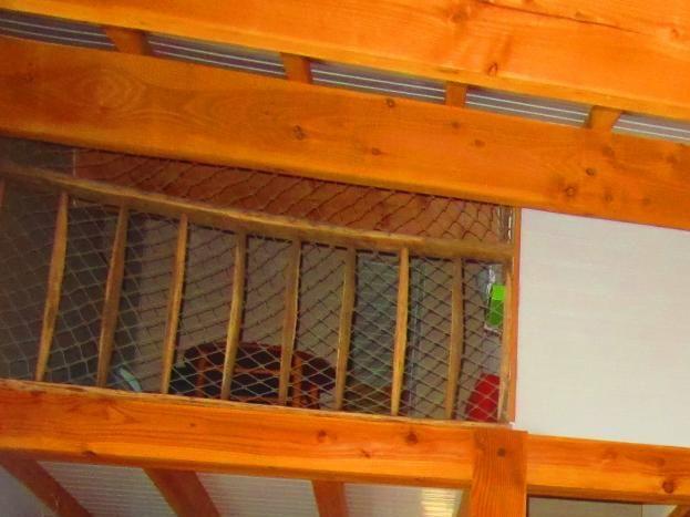 Pièce de vie avec accès à la mezzanine
